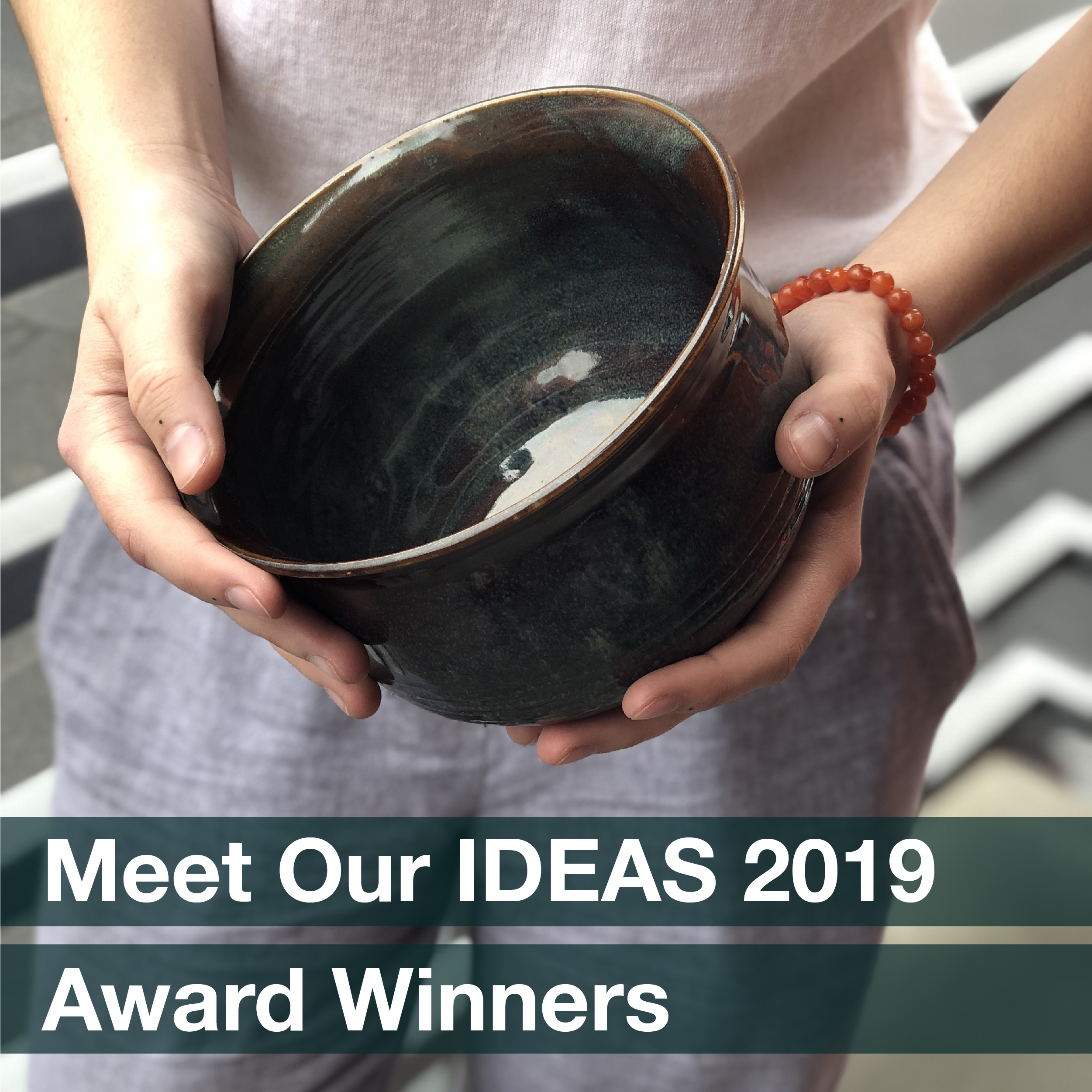 "Hands holding a handmade ceramic bowl, accompanied by the phrase ""Meet Our IDEAS 2019 award winners"""