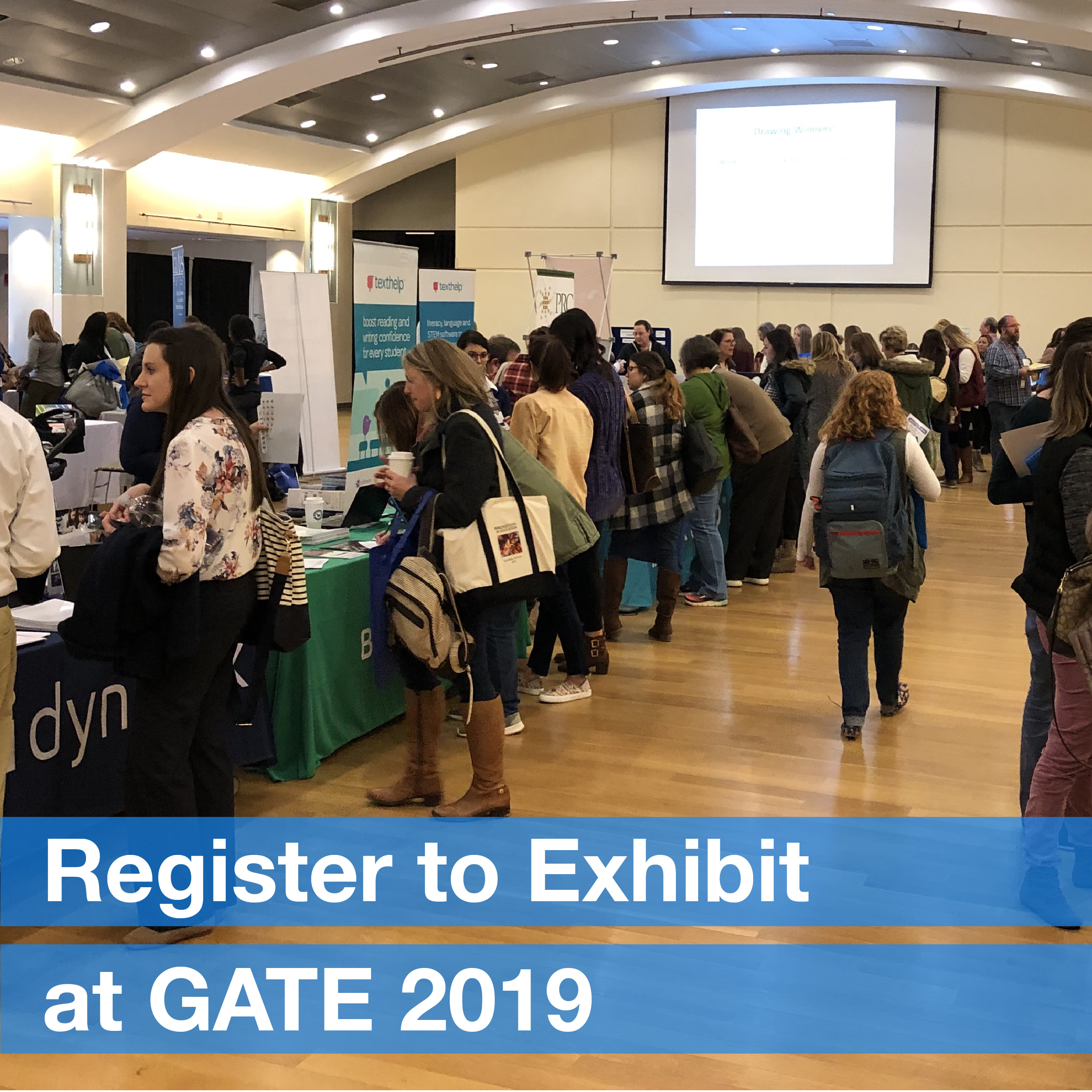 A large room with exhibit booths and people walking around interacting with one another. There is text on the image that reads: Register to exhibit at GATE 2019
